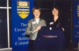 Margo presenting a coveted Trek Program t-shirt to Martha Piper