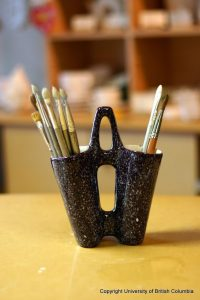 paint brushes in holder